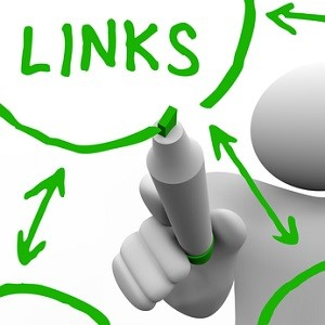A person draws a series of links connecting in a network of referrals, representing a well search engine optimized website or an organization of connected peopl